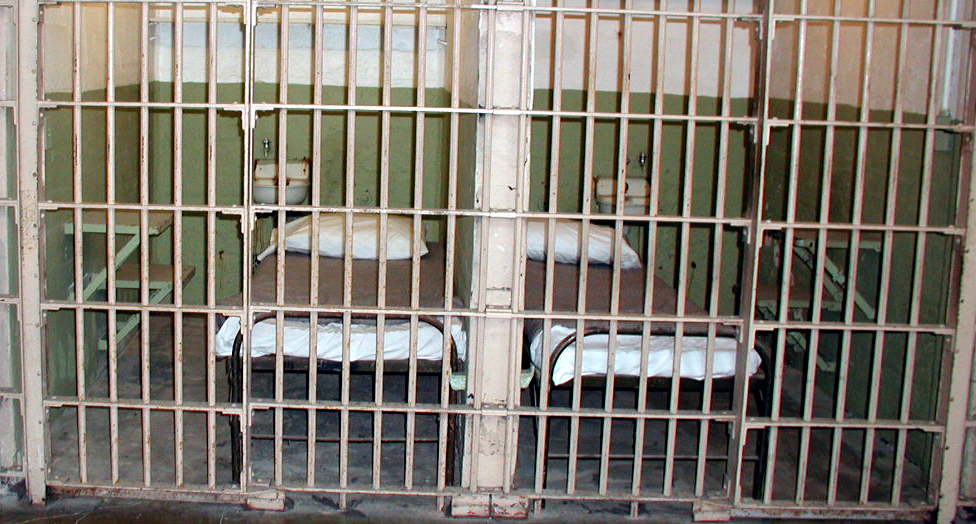 empty cell & beds